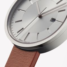 M40 date watch in brushed steel with tan nappa leather strap