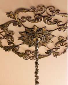 We love the idea of using a circular wall grill as a ceiling medallion above the chandelier