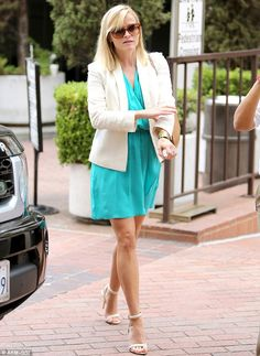 Lean and green: Reese Witherspoon arrived at Neiman Marcus for some shopping on Wednesday