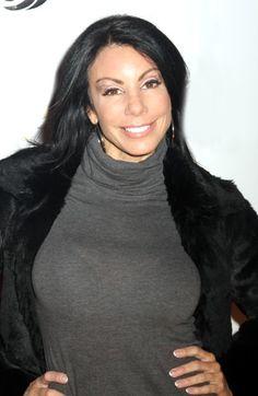 Danielle Staubs dark, long layered hairstyle