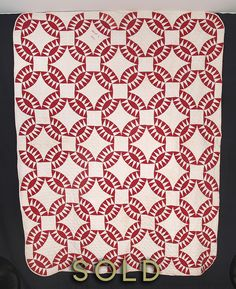 "Pickle Dish.  Dated March 4, 1905.    65"" x 82"".   This is a fabulously graphic quilt in deep turkey red and white cotton, completely hand pieced and hand quilted. The majority of the turkey red fabric is of an early date, and this quilt appears to be only lightly used. The quilting is a simple cross hatch, the backing is white cotton, and the ¼ - ½ inch binding has been turned over from the back."