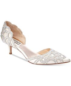 Breathtakingly timeless, Badgley Mischka's Ginny pumps combine the classic d'Orsay silhouette, a practical kitten heel and stunning rhinestone details. | Satin/suede upper; leather sole | Imported | P