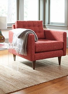 Our Sophie Collection Chair is grown-up furniture, a more standard sized chair. It has style all buttoned up, too: clean, sexy, sophisticated mid-century modern lines, and no skimping on the classic square biscuit-tufting detailing of the back.