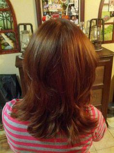 Deep chocolate brown on a layered haircut