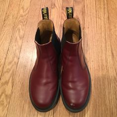 Dr. Martens dark cherry boots Dark cherry Dr. Martens Chelsea boots, worn once. Small scratch on front of left boot. Really sturdy boots, size 7 Dr. Martens Shoes Ankle Boots & Booties