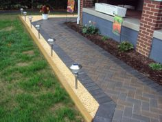 This job was designed and installed by Kingdom Landscaping. Follow the link for more pictures of their paver walkway jobs. http://kingdomlandscaping.com/gallery/?album=7