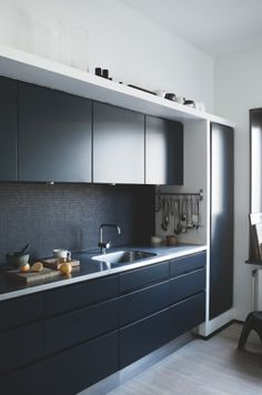 Stainless steel bench with black cupboards