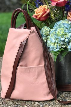 This Italian leather backpack purse is excellent for travel or every day use. The main compartment features a zippered enclosure and easily accommodates your wallet, cell phone, small umbrella, and other small items. The front slip pocket or back outside zipper pocket is great for those quick access items, like your passport. #backpackbags #womenbackpack #passportcover #stylishbackpacks #italianleatherbag #italianleatherhandbags #fashionstyle #travelessentials #pink Colorful Backpacks, Stylish Backpacks, Italian Leather Handbags, Leather Purses, Leather Backpack Purse, How To Make Handbags, Small Backpack, Cute Purses, Day Use