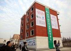 World's First 3D Printed Apartment Building Erects in China