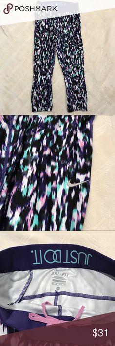 NWOT Nike Dri-Fit Run Capri in XS NWOT Nike Dri-Fit Run Capri in XS. Great pattern in purple, teal, white and black. Inside back says Just Do It. Nike Pants Track Pants & Joggers