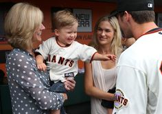BUSTER POSEY hangs out with his mom Traci, his son Lee, and his wife Kristin in the Giants dugout before he received his 2012 National League Most Valuable Player Award at AT& T Park. (Photo by Brad Mangin). Casey At The Bat, 49ers Players, 2014 World Series, Bye Bye Baby, Moving To San Francisco, Giants Baseball, Buster Posey, G Man, National League