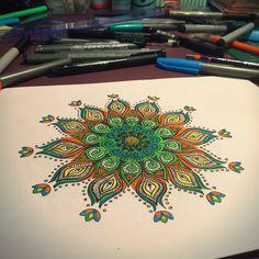 Mandala drawing  green, yellow, orange