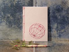 Red 3D Sphere. Hand Embroidered A5 Notebook. by FabulousCatPapers