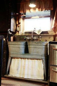 Old galvanized double wash tubs.used as a kitchen sink, how cute would that be for a cabin or summer kitchen?