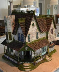 This is amazing. It is the same dollhouse kit I have but it looks nothing like mine! This shows how unique you can make your own! - DIY Fairy Gardens