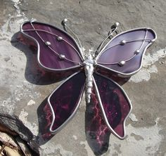This lavender- pink to plum butterfly suncatcher is a fun and unique decoration - great for gifts or to brighten your windows. The top is
