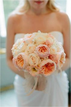 A classic bouquet of 'Juliet' garden roses and white roses
