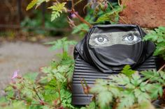 UK-based street artist 'My Dog Sighs' transforms used tin cans into small sculptures for people to take home.
