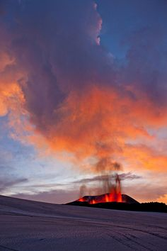 "This image illustrates the concept of both warmth and coolness. The red, ""hot"" colors from the erupting volcano contrast with the blue, ""cool"" colors of the snow and night sky.  http://www.pinterest.com/pin/92042386105284040/"