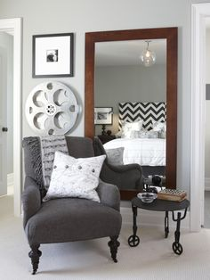 Using a large mirror in the bedroom not only creates the look of more space, it also adds depth and appeals to the overall aesthetic.