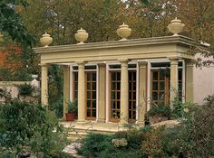 Beautiful Orangery solely using Haddonstone standard architectural components with Margam Swagged Urns.