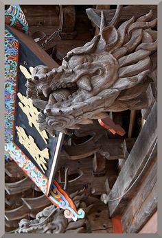 Carved wooden dragon - Temple Roof
