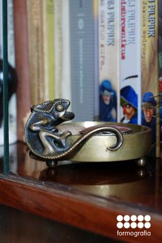 vintage brass ashtray in the shape of a chameleon