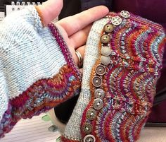 Free Knitting Pattern for Spatterdash Wristwarmers - Designed by Dagmar Mora, these fingerless mitts are knit flat and wrapped around the hand to imitate spats. The feather and fan lace gives a lovely texture that showcases variegated yarn well, yet also works well with solid yarn. Sizes: Women's S[M, L] Pictured project by johannab