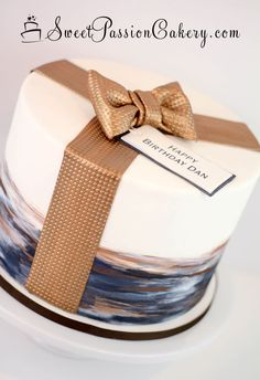 Inspired by one of Sweetlake Cakes amazing creations, we created this simple masculine birthday cake. Had painted in blues, bronzes and whites =). www.sweetpassioncakery.com