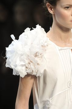 Sculptured sleeve with curled fabric petals in soft white; feminine fashion details // Christophe Josse
