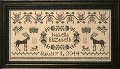 La D Da Honeysuckle Birth Sampler - Cross Stitch Pattern. Model stitched on 32 Ct. Beige linen with Weeks Dye Works Floss (or DMC 839, 3768, 934, 3721, 3031, 45