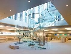 Apple's iconic glass stairway and a pneumatic tube-like elevator bring shoppers down into the store, while light pours in from above.    vaholderINdesign.com