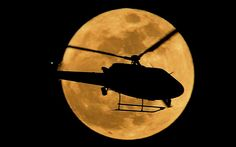 Any rises in crime, bizarre behavior or natural disasters due to the full moon have been dismissed by scientists as a myth    PICTURE: An LAPD helicopter flies in front of the moon  Picture: Joe Klamar/AFP/GettyImages