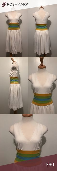 Diane Von Furstenberg Fit and Flare Dress Ivory dress with yellow, green and blue tripes running down waist. Has pockets and side zipper. V neckline and back. Diane von Furstenberg Dresses