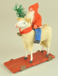 Lot # : 1925 - SANTA CLAUS ON SHEEP PULL TOY