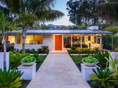 Midcentury Tropical Villa Gets Modern Update | Neumann Mendro Andrulaitis Architects | HGTV