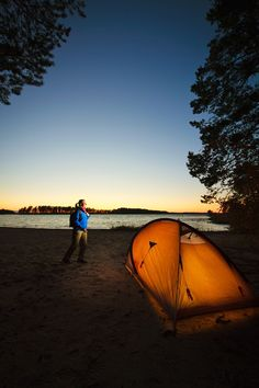 Backpacker camping (108714). beach, business, calm, camping, country, health, healthy, hiking, holidays, lake, man, nature, night, outdoor activities