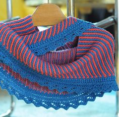 Free Knitting Pattern for Sencillo Shawl - Garter stitch striped shawl with shaped lace border. The shawl can be worked as a long slender slightly curved shawlette or a triangular shawl. Designed by by britt schmiesing. Available in English and German. Great with multi-colored yarn! Pictured project by ksushi
