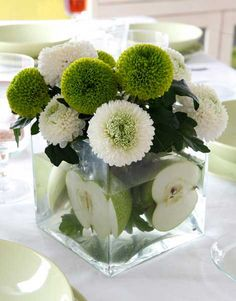 Pinning for this flower arrangement, love the mums,  green-apple-fan-theme-dinner-decorations2.jpg