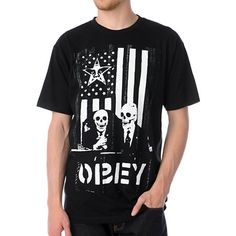 Obey DK short sleeve guy's tee shirt is a poke at the way the US does politics. The front features a black and white American flag with an Andre star in the corner two skeletons dressed as polititions. This crew neck tee shirt from Obey is a classic that will not go out of style as long as there are old skeletons running the country. Make a statement and look good doing it in the Obey DK black short sleeve tee shirt.