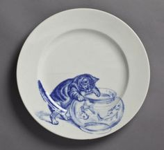 Minton plate, 1873 - 1891, at Kingston Lacy, Dorse  Minton plate, 1873 - 1891, at Kingston Lacy, Dorset. One of a set of plates, each decorated with a different image of cats. NT Inventory number: 1250703.