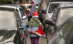 Merry Christmas! Samira, 6, looks for customers as she sells Christmas hats at a traffic intersection in Cairo, Egypt on Dec. 12, 2013. - Found via Buzzfeed