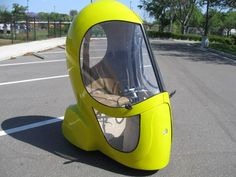 Riding a scooter to work or school is a fantastic way to save on both gas money and environmental emissions. But riding in the rain or snow is usually not an . Electric Cars, Electric Vehicle, Urban Electric, Automobile, Microcar, Volkswagen, New Inventions, Egg Shape, Car Humor