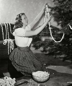 Making popcorn garlands for the tree....something many families did together....well, at least us kids did :)