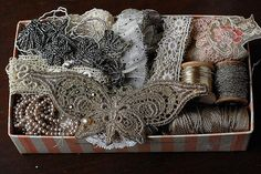 Antique lace and french metal threads in a box
