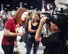 DP Mark Schulze shoots an interview on the floor of the San Diego Comic Con with Weird Al Yankovic and Julie Stouffer (Photo credit: San Diego video producer Patty Mooney of Crystal Pyramid Productions) Comic Conventions, Business Video, San Diego Comic Con, Sci Fi Movies, Vintage Photographs, Photo Credit, Weird, The Past, Interview