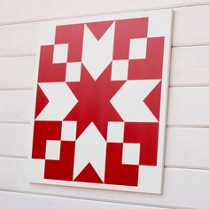 This bold red barn block is 23 inches square, approximately 4.5 pounds and is unlike any other barn quilt you've seen before. Each barn quilt is made from heavy duty 10 mm thick plastic, printed with UV-resistant ink to prevent fading for indoor or outdoor display. You can easily drill holes for mounting or use your favorite hanging hardware. We've used industrial strength Velcro throughout our wettest winter in a century. (Hardware is not included.) Barn quilts aren't just for barns. You…