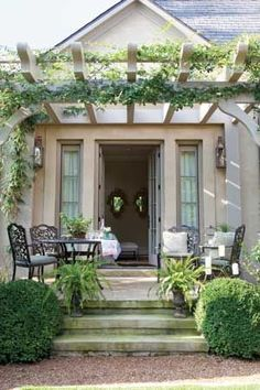 Pretty Porch Furnishings...I like the arbor over f...