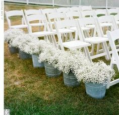 White Folding Chairs  Buckets of baby breath!
