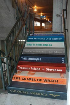 Stairs painted to look like books.